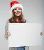 Woman christmas portrait hold white banner. Santa Christmas hat Stock Photo