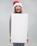 Woman christmas portrait hold white banner. Santa  Stock Images