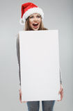 Woman christmas portrait hold white banner. Santa  Royalty Free Stock Photo