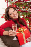 Woman with Christmas present Stock Photo