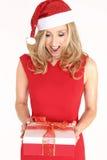 Woman with Christmas present stock image