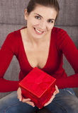 Woman with a christmas present Stock Images