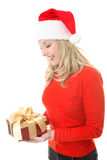 Woman with Christmas present Stock Photos