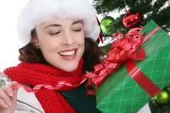 Woman with Christmas present Royalty Free Stock Photos