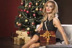 Woman with christmas present box Stock Images