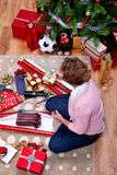 Woman with Christmas presents overhead Royalty Free Stock Photo