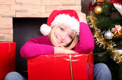 Woman with christmas presents wearing santa hat Stock Photos