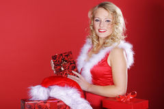 Woman with Christmas presents Stock Images