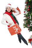 Woman and Christmas sale Stock Images