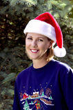 Woman in a Christmas setting Stock Images