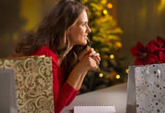 Woman among Christmas shopping bagsthinking what's left to do Royalty Free Stock Images