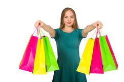 The woman in christmas shopping concept on white. Woman in christmas shopping concept on white Royalty Free Stock Photos