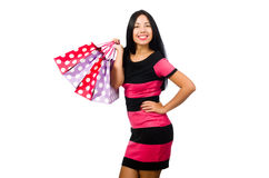 Woman in christmas shopping concept on white. The woman in christmas shopping concept on white Royalty Free Stock Images