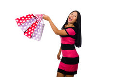 Woman in christmas shopping concept on white. The woman in christmas shopping concept on white Royalty Free Stock Photo