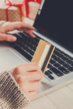 Woman christmas shopping online with a credit card Stock Image