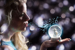Woman with christmas snow globe Royalty Free Stock Image
