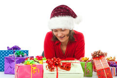 Woman with christmas surprised between many gifts Royalty Free Stock Photo