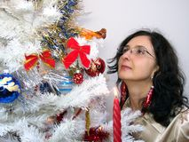 Woman looking Christmas tree Royalty Free Stock Photos