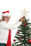 Woman with Christmas tree Stock Photography