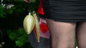 Woman with christmas tree decorations stock video