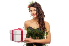 Woman in christmas tree dress. With gift box isolated on white Stock Photography