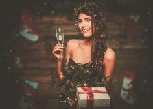 Woman in christmas tree dress Stock Images