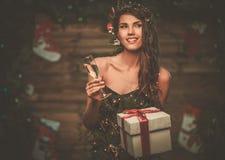 Woman in christmas tree dress Stock Photos