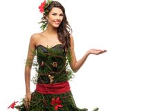 Woman in christmas tree dress. Isolated on white Stock Image
