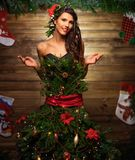 Woman in christmas tree dress Stock Image