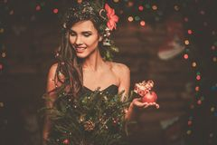 Woman in christmas tree dress Royalty Free Stock Photos