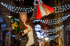 Woman with Christmas tree, gift and shopping bags in Venice Royalty Free Stock Photography