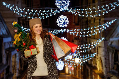 Woman with Christmas tree, gift and shopping bags in Venice Royalty Free Stock Photo