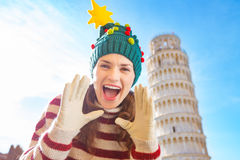 Woman in Christmas tree hat shouting in front of Leaning Tour Stock Images