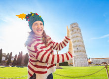 Woman in Christmas tree hat supporting Leaning Tour of Pisa Stock Image