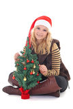 Woman with christmas tree isolated on white Royalty Free Stock Photos