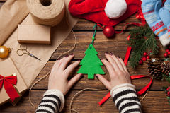 Woman and christmas tree toy Royalty Free Stock Photo