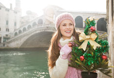 Woman with Christmas tree in Venice looking into distance Royalty Free Stock Photography
