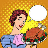 Woman with a Christmas Turkey thanksgiving Royalty Free Stock Photos