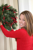 Woman and Christmas Wreath Royalty Free Stock Image