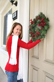 Woman and Christmas Wreath Royalty Free Stock Photography
