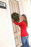 Woman and Christmas Wreath Stock Photography