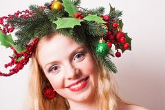 Stylish Christmas headdress. Woman in Christmas wreath. Stylish headdress for holiday party or photo shooting Stock Images