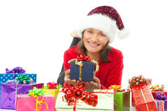Woman with chritmas hat between gifts Stock Photo