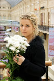 Woman with chrysanthemum flowers Stock Images