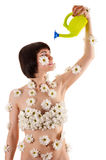 Woman with chrysanthemums on the body himself watering Royalty Free Stock Photography