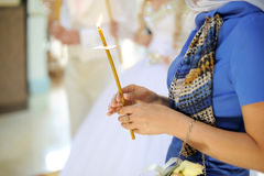 Woman with Church Candle Royalty Free Stock Photography