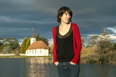Woman by church and lake Royalty Free Stock Photography