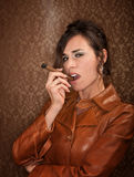 Woman with cigar Royalty Free Stock Photos