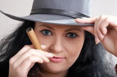 Woman with cigar Royalty Free Stock Images