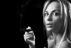 Woman with cigar Royalty Free Stock Photography